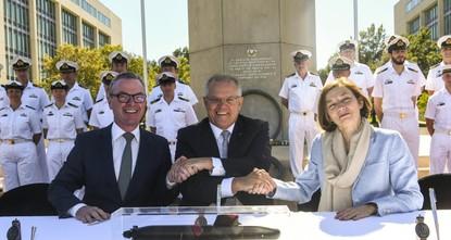 Australia signs $35 billion submarine deal with French shipbuilder Naval