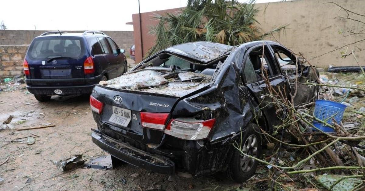 A damaged car is seen after an air strike at Tajura neighbourhood, east of Tripoli, Dec. 30, 2019.  (REUTERS PHOTO)