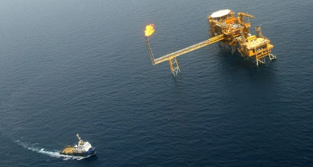 This May 16, 2004 shows an aerial view of the Balal offshore oil platform on the edge of Qatar's territorial waters in the Persian Gulf, following the inauguration of the offshore oil field developed by Total, BowValley and Agip. (AFP Photo)