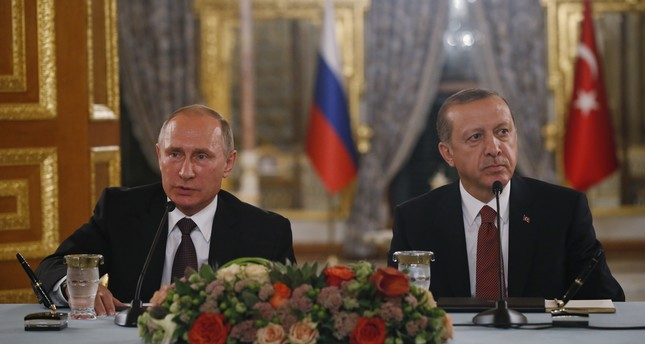 Russian President Vladimir Putin L and his Turkish counterpart Tayyip Erdogan give news conference following their meeting in Istanbul, Turkey, October 10, 2016. AP Photo