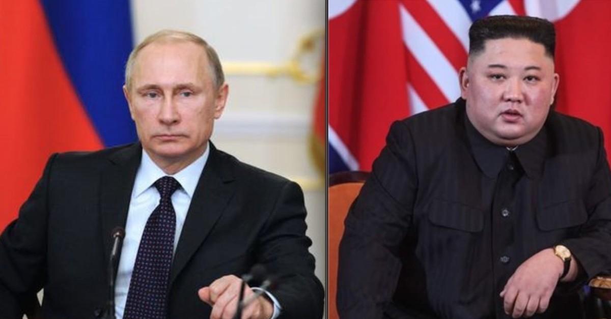 Russian President Vladimir Putin (L) and North Korean Chairman Kim Jong Un