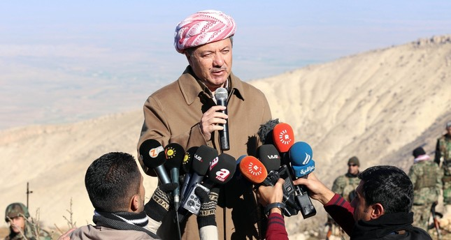 KRG leader Masoud Barzani speaks to journalists during a visit to Sinjar in northwestern Iraq, Dec. 21, 2014.