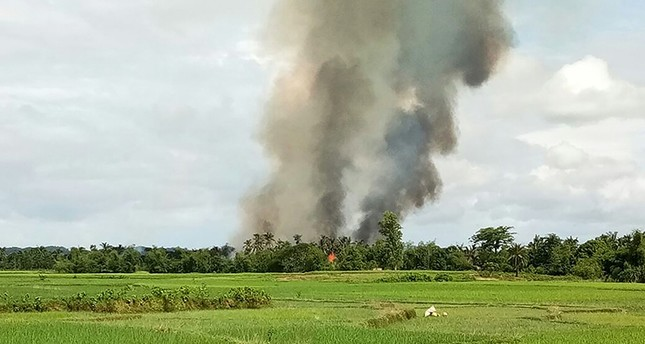 Smoke rises from what is believed to be a burning village in the area near Maungdaw in Myanmar's Rakhine state on Aug. 30, 2017. (AFP Photo)