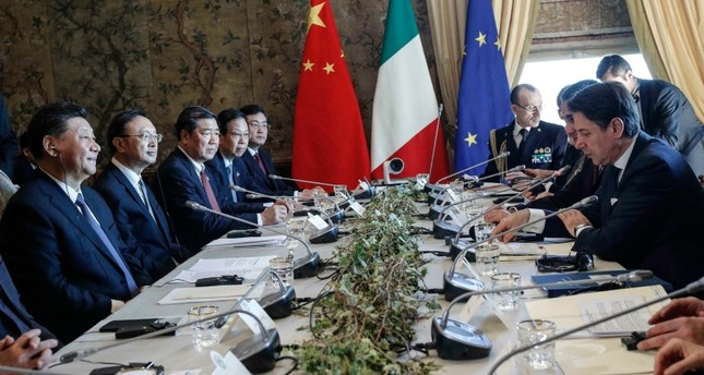 Chinese President Xi Jinping, left, sits in front of the Italian Premier Giuseppe Conte ahead of the signing ceremony of a memorandum of understanding at Rome's Villa Madama, Saturday, March 23, 2019. (Giuseppe Lami/ANSA via AP)