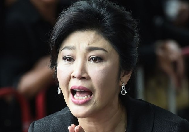 Former Thai Prime Minister Yingluck Shinawatra speaking to the media as she arrives at the Supreme Court in Bangkok on July 21, 2017.