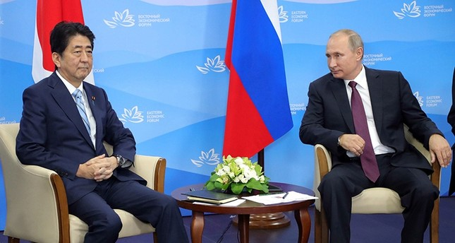 Russian President Vladimir Putin (C) and Japanese Prime Minister Shinzo Abe (L) during their bilateral meeting on the sidelines of the Eastern Economic Forum at the Far Eastern Federal University (EPA Photo)