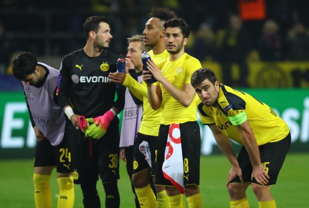 Dortmund's players react after losing 2-3 during the Champions League quarterfinal first leg match between Borussia Dortmund and AS Monaco in Dortmund.