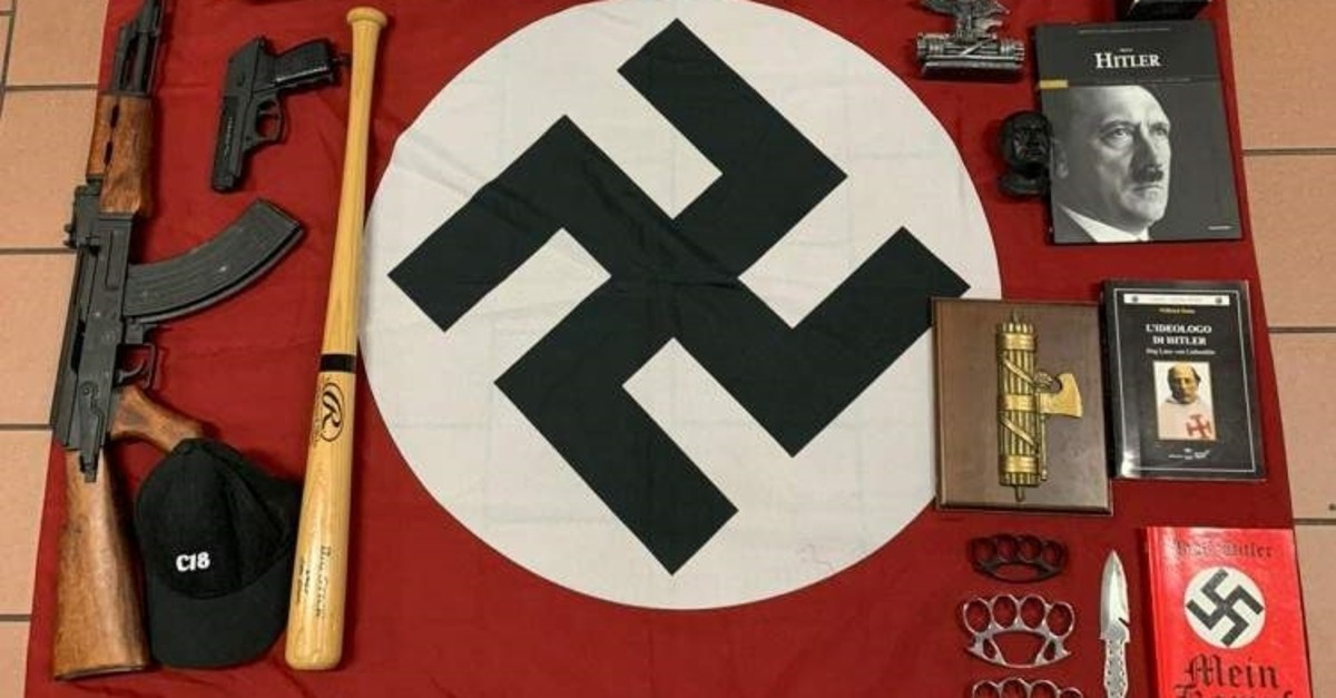Italian police handout shows weapons and a Nazi flag with a swastika seized from an extreme right group that planned to create a new Nazi party, in an unidentified location in Italy, Nov. 28, 2019. (Polizia di Stato/Handout via Reuters)