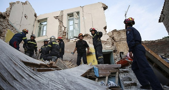 Fire department rescue team search for survivors, trapped in a collapsed house in the village of Vrissas, following a strong earthquake struck Lesvos island, in Greece, 12 June 2017. (EPA Photo)