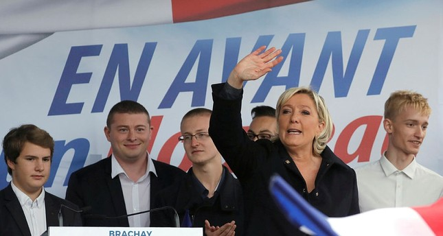 Marine Le Pen waves to supporters as she attends a political rally in Brachay, northern France, September 9, 2017. (REUTERS Photo)