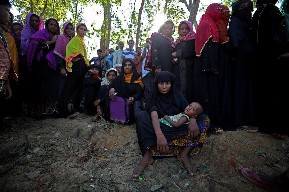 Rohingya refugees line up to receive humanitarian aid at the Kutupalong refugee camp near Cox's Bazar, Bangladesh, Oct. 23.