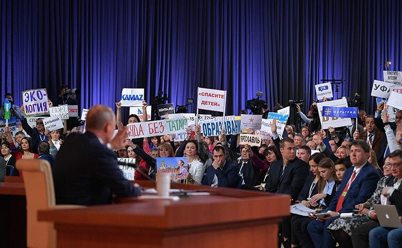 Journalists raise placards as Russian President Vladimir Putin gives his annual press conference in Moscow, Russia, Dec. 14, 2017. (AFP Photo)