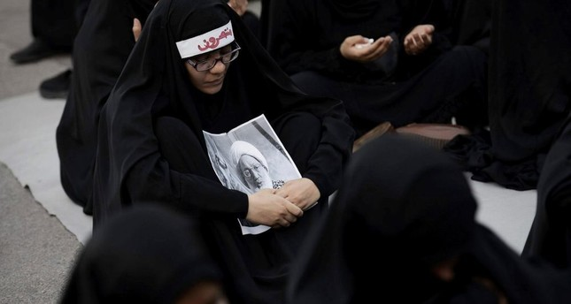 Hardline Bahraini Shiite demonstrators attend a protest against the revocation of the citizenship of a top Bahraini Shiite cleric.