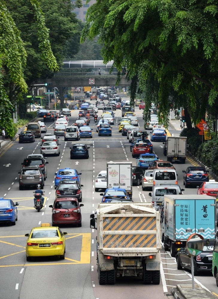 Motorists enter the financial district area in Singapore. The country is one of the most expensive places in the world to buy a vehicle.