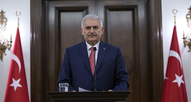 Prime Minister Binali Yıldırım makes a speech regarding the snap presidential and parliamentary election to be held on June 24, 2018 during a press conference at the Çankaya Palace in Ankara, on April 18, 2018. (AFP Photo)