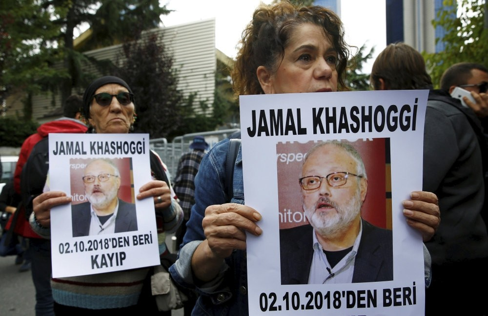 Human rights activists hold pictures of Khashoggi during a protest outside the Saudi Consulate in Istanbul, Oct. 9.
