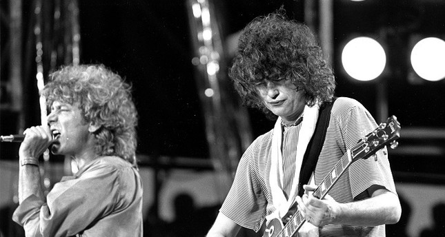 In this July 13, 1985 file photo, singer Robert Plant, left, and guitarist Jimmy Page of the British rock band Led Zeppelin perform at the Live Aid concert at Philadelphia's J.F.K. Stadium. (AP Photo)