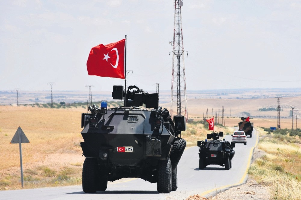 Turkish security forces near Manbij, northern Syria, during independent patrolling, as part of the agreement with the U.S., June 22.