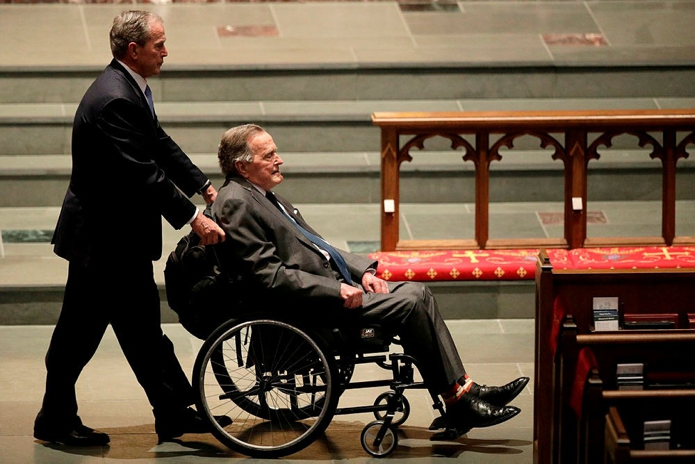 Former presidents George W. Bush, left, and George H.W. Bush arrive at St. Martin's Episcopal Church for a funeral service for former first lady Barbara Bush in Houston.  (AP Photo)