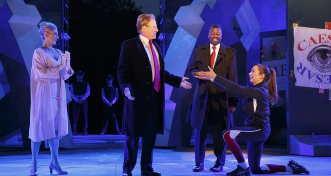 Tina Benko, left, portrays Melania Trump in the role of Caesar's wife, Calpurnia, and Gregg Henry, center left, portrays President Donald Trump in the role of Julius Caesar during a dress rehearsal.