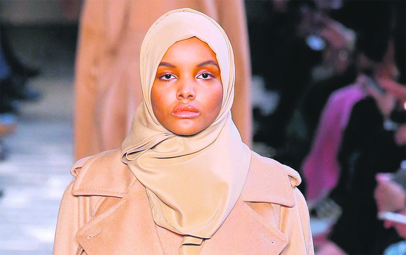 Somali-American model Halima Aden wears a creation from the Max Mara womenu2019s Fall-Winter 2017-18 collection, presented in Milan, Italy, Feb. 23, 2017.