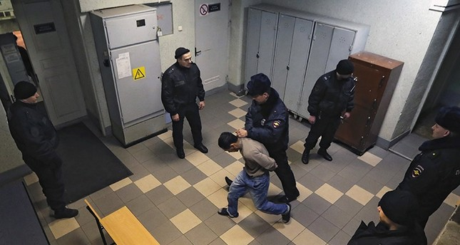 A man suspected in involvement in organizing St. Petersburg metro blast is escorted inside the Oktyabrsky district court in St. Petersburg, Russia, 07 April 2017. (EPA Photo)