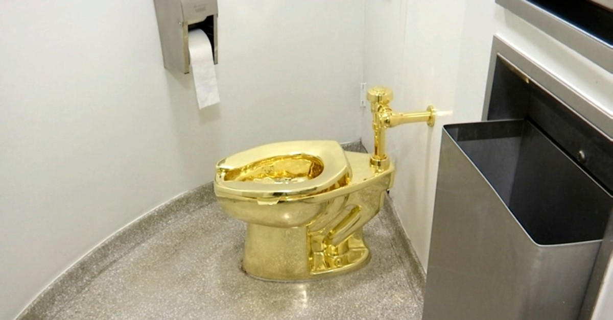 This Sept. 16, 2016 file image made from a video shows the 18-karat toilet, titled ,America,, by Maurizio Cattelan in the restroom of the Solomon R. Guggenheim Museum in New York (AP Photo)