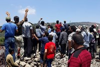 Syrians protest near Golan Heights after airstrike on school shelter kills 10