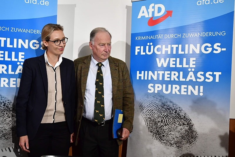 The leading candidates of the anti-immigration and Islamophobic party AfD (Alternative fu00fcr Deutschland), Alexander Gauland and Alice Weidel, pose ahead of a press conference about immigration and Islam on September 18, 2017 in Berlin  (AFP Photo)