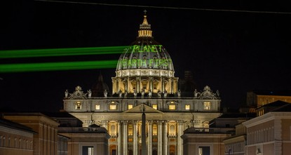 pThe message Planet Earth First was projected in bright green light on the dome of St. Peter's Basilica by Greenpeace activists on the eve of U.S. President Donald Trump's meeting with Pope...