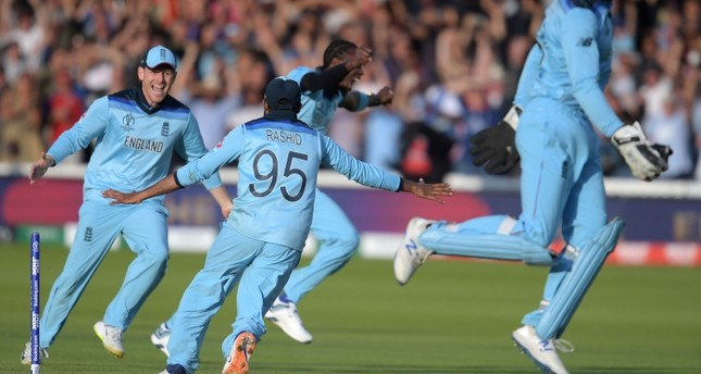 England's captain Eoin Morgan (L) celebrates with his players after victory in the 2019 Cricket World Cup final between England and New Zealand at Lord's Cricket Ground in London on July 14, 2019. (AFP Photo)