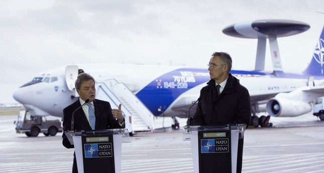 NATO Secretary General, Jens Stoltenberg, right, and the President of Boeing International, Sir Michael Arthur, speak during a media conference at Melsbroek military airport in Melsbroek, Belgium, Nov. 27, 2019. (AP Photo)