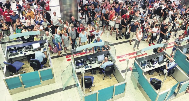 Tourists wait for security and passport control at Antalya International Airport on Sept. 10, 2016.