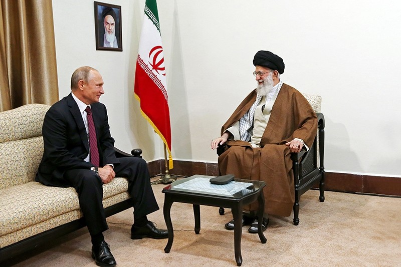 In this picture released by the office of the Iranian supreme leader, Supreme Leader Ayatollah Ali Khamenei, right, speaks with Russian President Vladimir Putin during their meeting in Tehran, Iran, Wednesday, Nov. 1, 2017 (AP Photo)