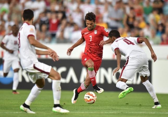 Iran's Masoud Shojaei (C), during a game against Qatar. (AFP Photo)