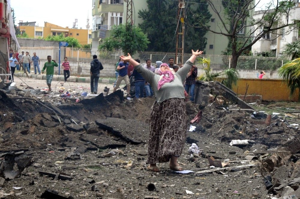Du00f6ne Kuvvet became a symbol of grief for the Reyhanlu0131 victims when a photo showing her with her hands stretched to the sky in sorrow while standing in a crater blast created made headlines. Kuvvet's daughter & granddaughter were killed in the blasts.
