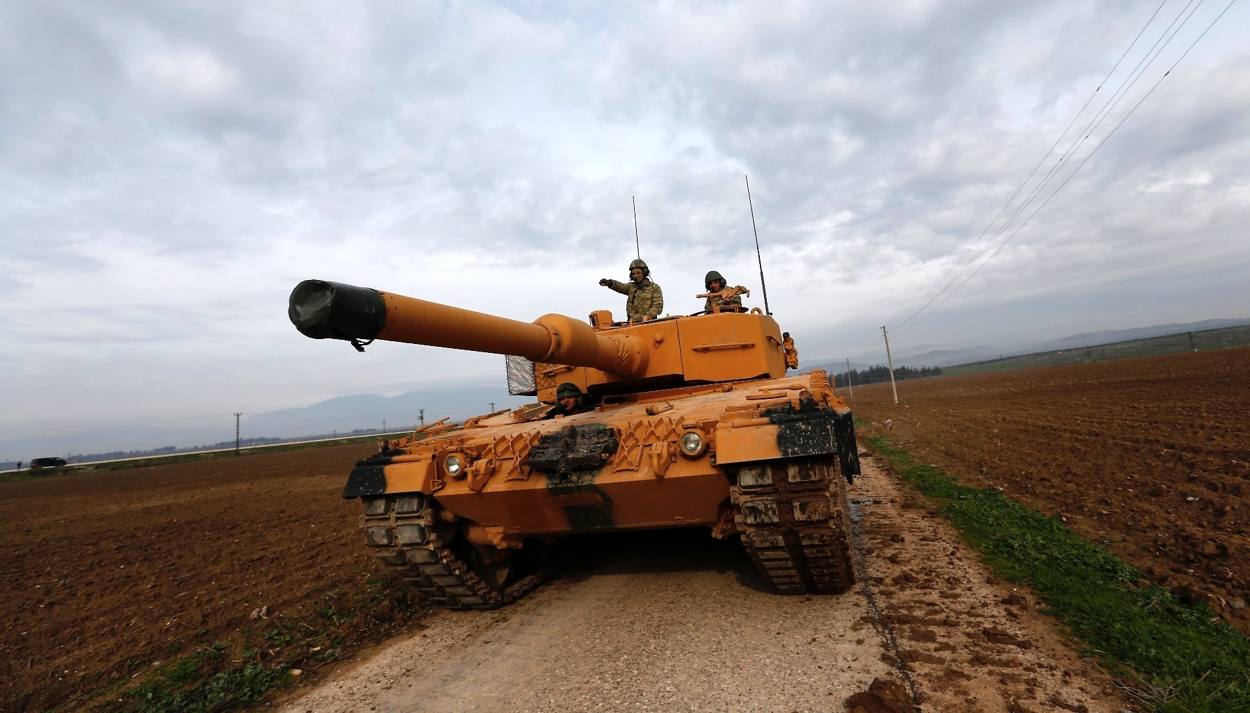 Turkish soldiers prepare tanks near the  Syrian-Turkish border, Reyhanli, Hatay, Jan. 21.