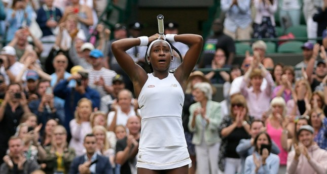 United States' Cori Coco Gauff reacts after beating United States's Venus Williams in a Women's singles match during day one of the Wimbledon Tennis Championships in London, Monday, July 1, 2019. (AP Photo)