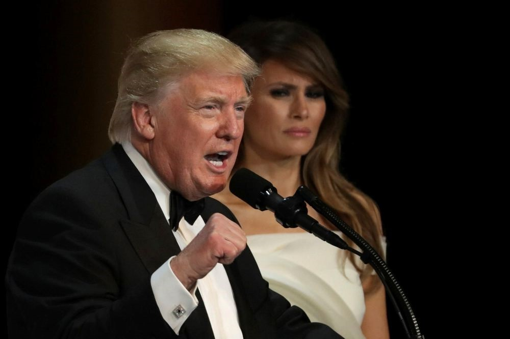 U.S. President Donald Trump speaks as his wife First Lady Melania Trump looks on during A Salute To Our Armed Services Inaugural Ball at the National Building Museum on Jan. 20.