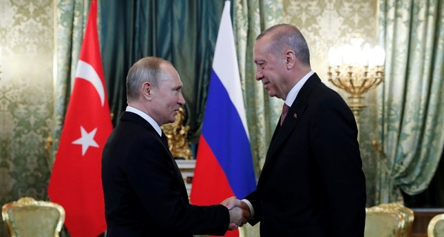 President Recep Tayyip Erdoğan shakes hands with Russian President Vladimir Putin during a meeting in the Kremlin, Moscow, April 8, 2019.