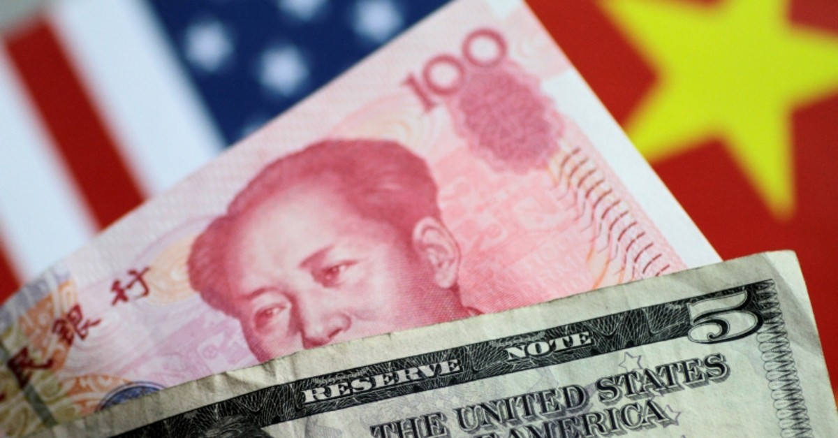 U.S. dollar and Chinese yuan notes are seen in this picture illustration June 2, 2017. (Reuters Photo)