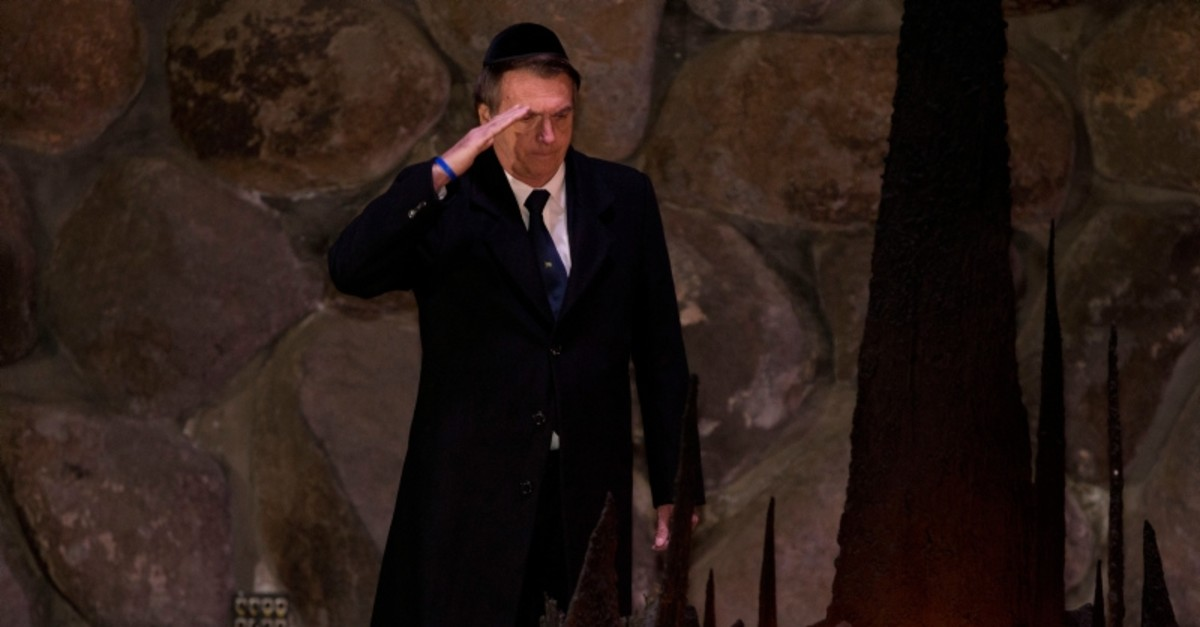 Brazil's President Jair Bolsonaro salutes during a ceremony commemorating the six million Jews killed by the Nazis during the Holocaust, in the Hall of Remembrance at Yad Vashem World Holocaust Remembrance Center Jerusalem, April 2, 2019. (AP Photo)