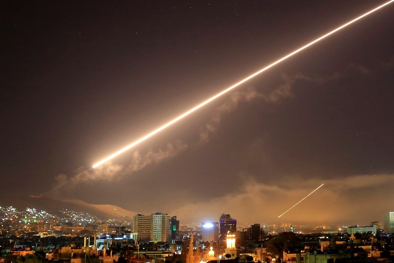 Damascus skies erupt with surface to air missile fire as the U.S. launches an attack on Syria targeting different parts of the Syrian capital Damascus, Syria, early Saturday, April 14, 2018. (AP Photo)