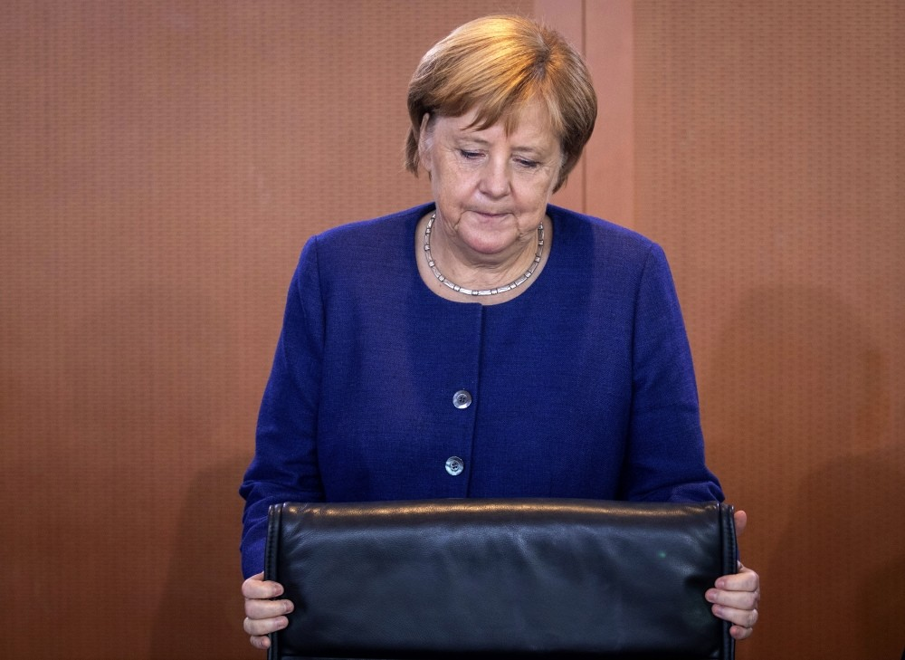 German Chancellor Angela Merkel takes her seat prior to the weekly cabinet meeting, Berlin, Sept. 26.
