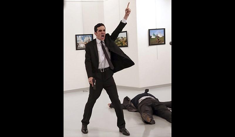 Assassin Mevlu00fct Mert Altu0131ntau015f shouts after shooting Andrei Karlov, right, the Russian ambassador to Turkey, at an art gallery in Ankara, Turkey. Dec. 19, 2016. (AP Photo/Burhan Ozbilici, File)