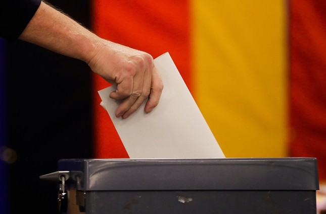 A voter casts for Germany's general election at a polling station in Berlin, Sunday, Sept. 24, 2017. (AP Photo)