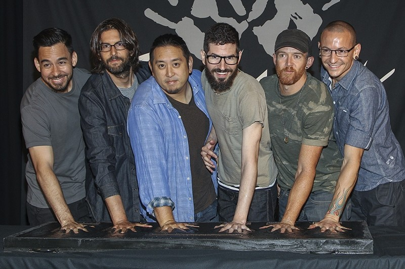This June 18, 2014 file photo shows members of Linkin Park, (L-R) Mike Shinoda, Rob Bourdon, Joe Hahn, Brad Delson, Dave Farrell and Chester Bennington. (AP Photo)