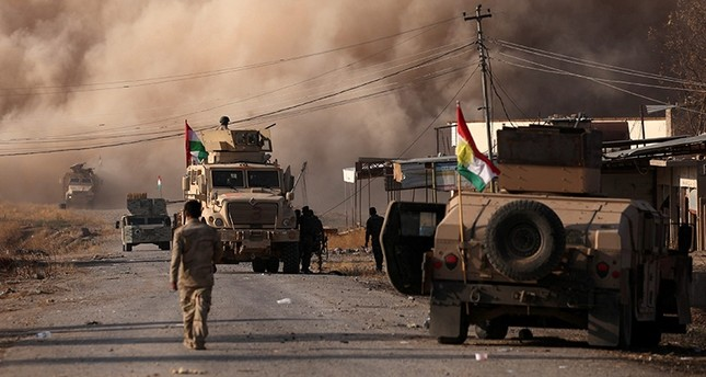 Smoke rises during clashes between Peshmerga forces and Islamic State militants in the town of Bashiqa, east of Mosul (Reuters File Photo)