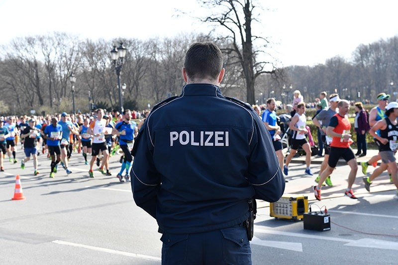 Police patrol during the half-marathon in Berlin on April 8, 2018. (AFP Photo)