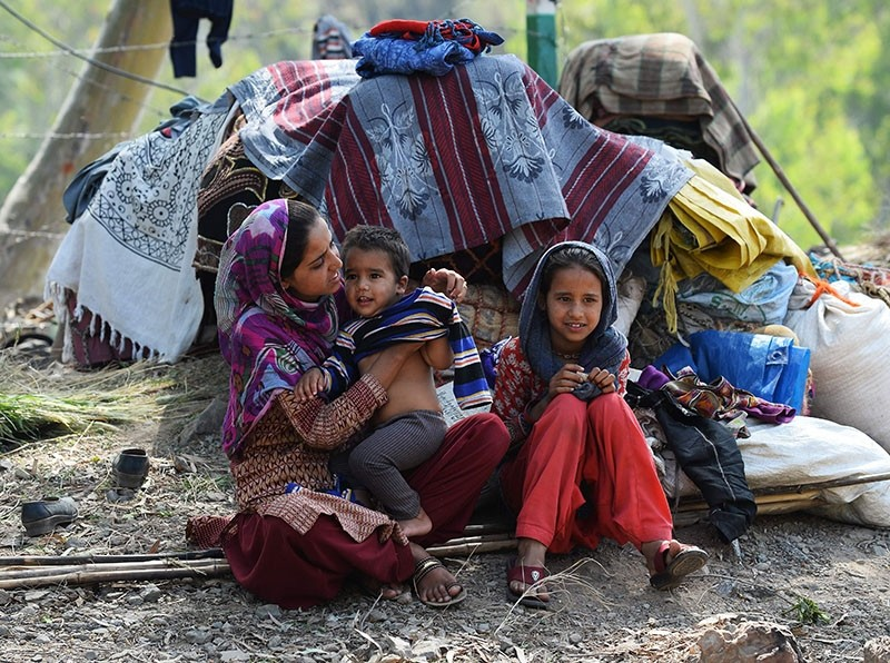 This photo taken on April 18, 2018 shows a Kashmiri Muslim Bakarwal family sitting at a temporary camp near Udhampur, some 72 kilometer north of Jammu in northern India. (AFP Photo)